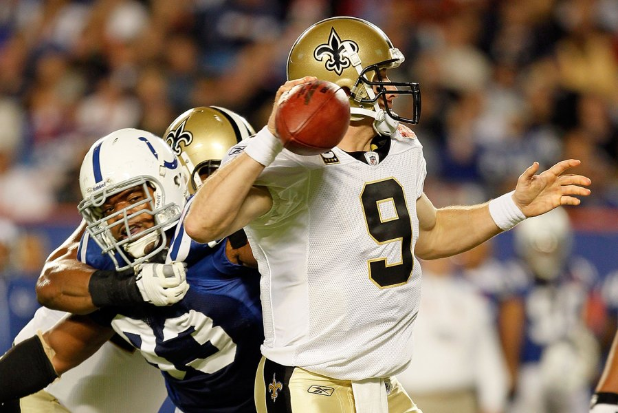 MIAMI GARDENS, FL - FEBRUARY 07: Dwight Freeney #93 of the Indianapolis Colts pressures Drew Brees #9 of the New Orleans Saints during Super Bowl XLIV on February 7, 2010 at Sun Life Stadium in Miami Gardens, Florida.