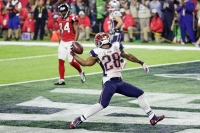 HOUSTON, TX - FEBRUARY 05: James White #28 of the New England Patriots celebrates rushing for a 1-yard touchdown in the fourth quarter against the Atlanta Falcons during Super Bowl 51 at NRG Stadium on February 5, 2017 in Houston, Texas.