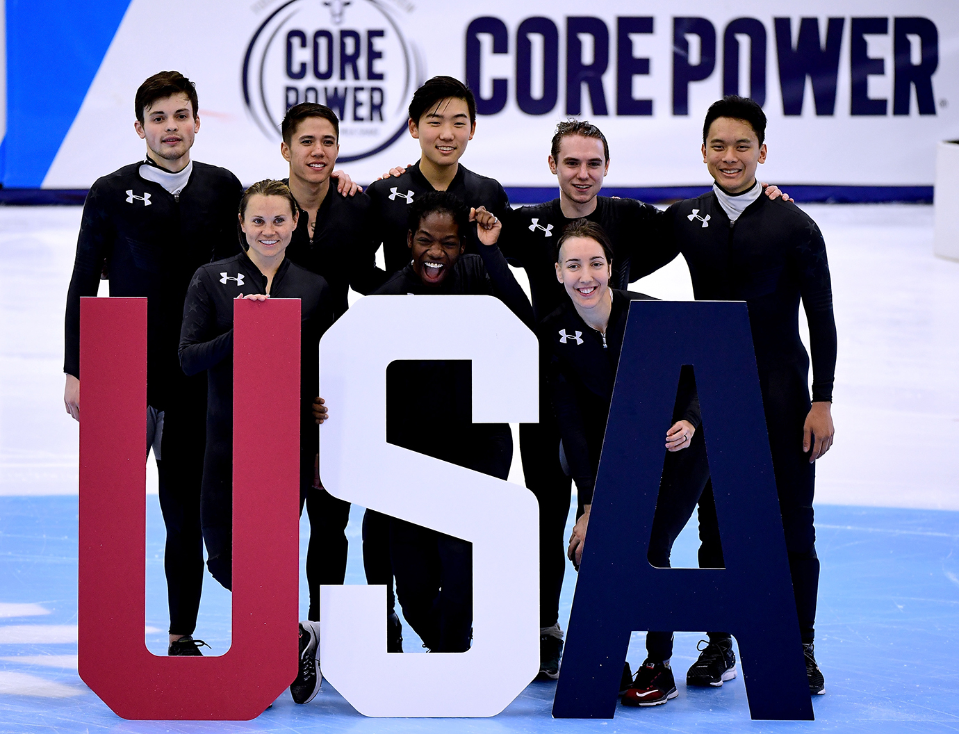 From left to right: John-Henry Krueger, Jessica Kooreman, J.R. Celski, Maame Biney, Thomas Insuk Hong, Lana Gehring, Ryan Pivirotto and Aaron Tran posing for a photo during the 2018 U.S. Speedskating Short Track Olympic Team Trials at the Utah Olympic Oval on December 17, 2017 in Salt Lake City, Utah.