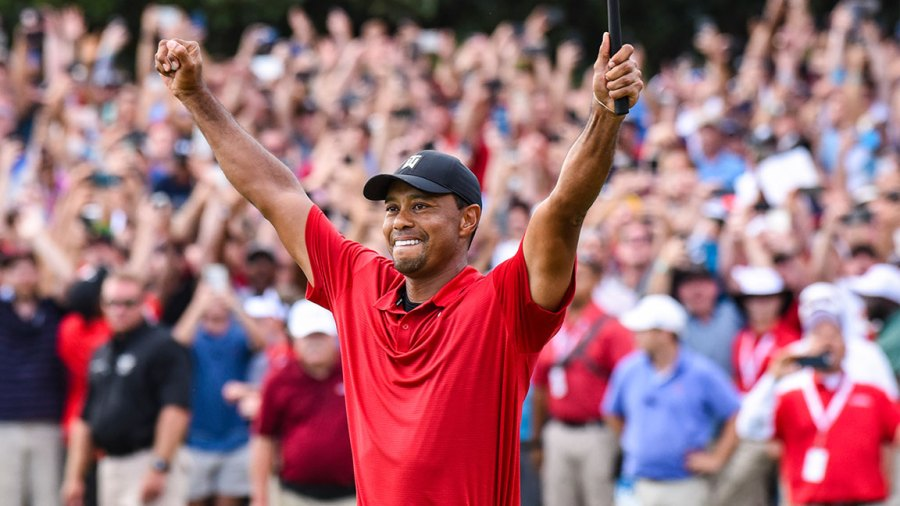 Tiger Woods celebrates his two stroke victory on the 18th hole green during the final round of the TOUR Championship, the final event of the FedExCup Playoffs, at East Lake Golf Club on September 23, 2018 in Atlanta, Georgia. (Photo by Keyur Khamar/PGA TOUR)