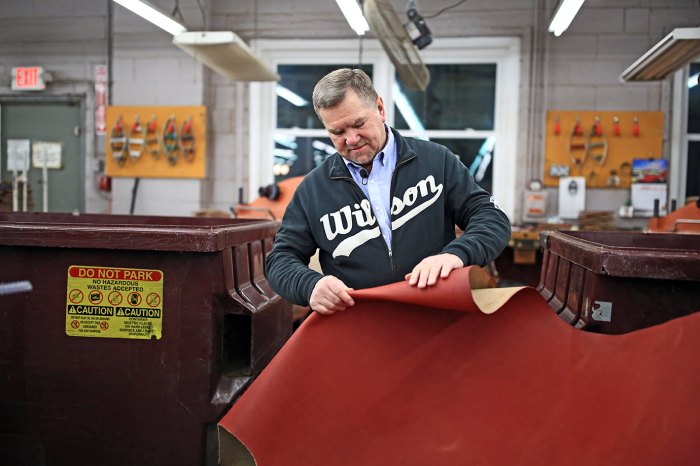 Wilson's Ada, Ohio plant manager, Dan Riegle, inspects the Horween leather that goes into the company's official Super Bowl Balls.