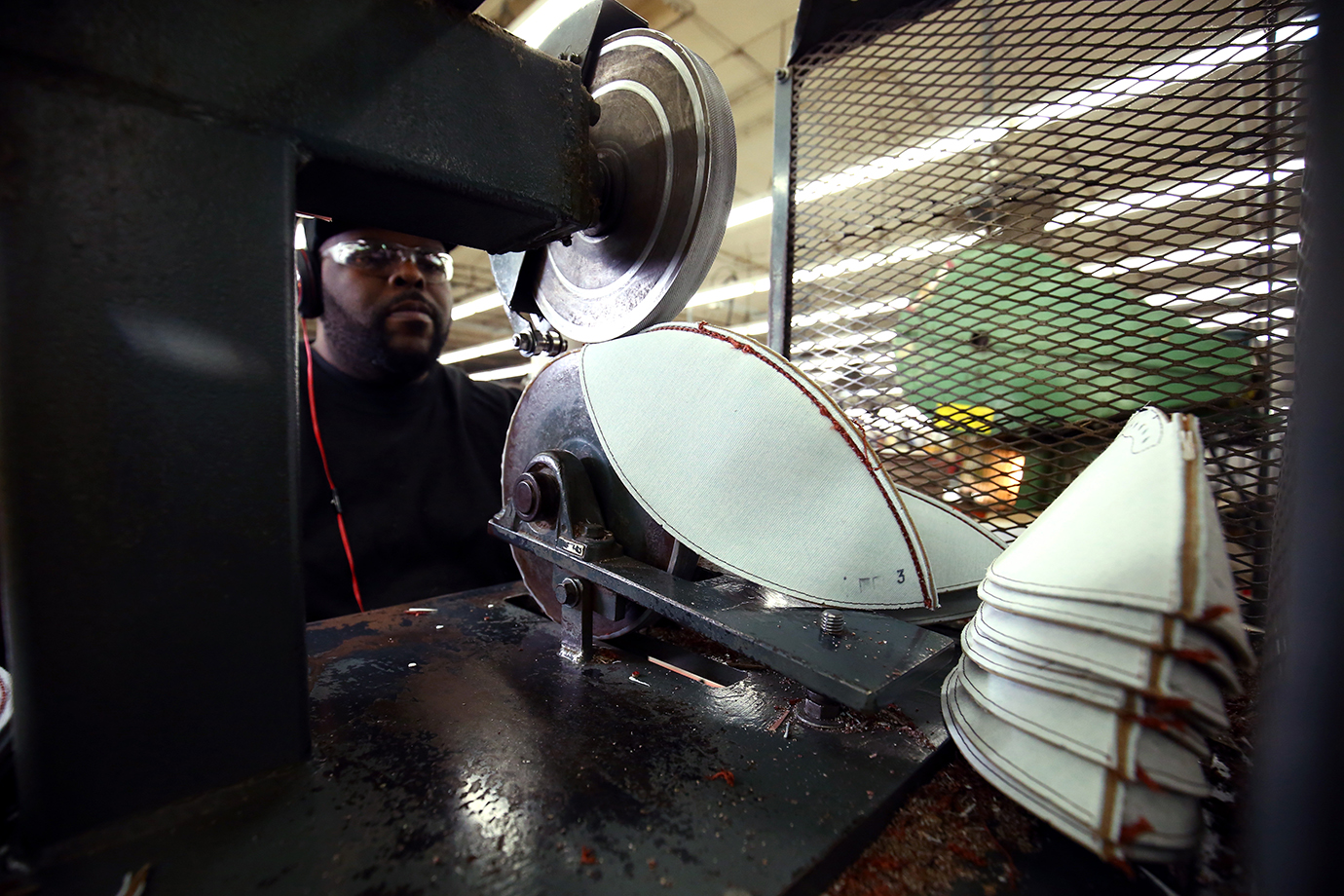 An employee of Wilson's Ada, Ohio factory sews panels of the Super Bowl balls together.