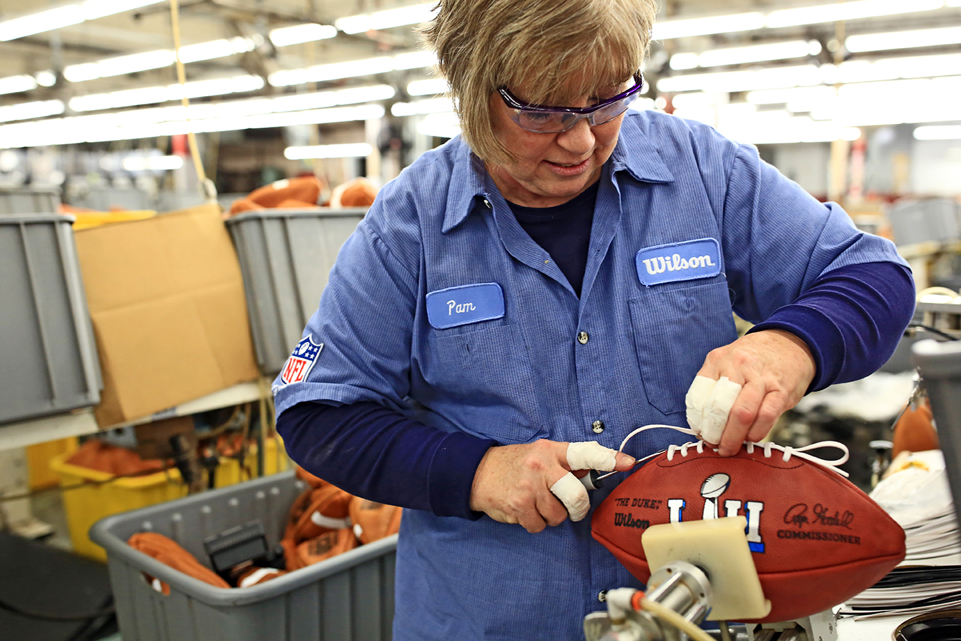 Pam Boutwell, an employee at Wilson's Ada, Ohio factory, stitches one of the official Super Bowl balls.