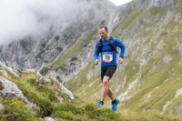 Man running ultramarathon on mountain