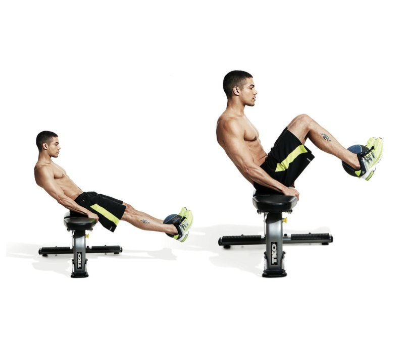 Best ab exercises to get a six-pack — Medicinal ball seated knee tuck