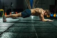 Athletic man doing the plank for abs and core