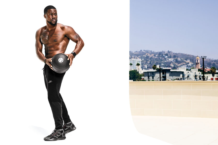 Kevin Hart posing with medicine ball photoshoot /