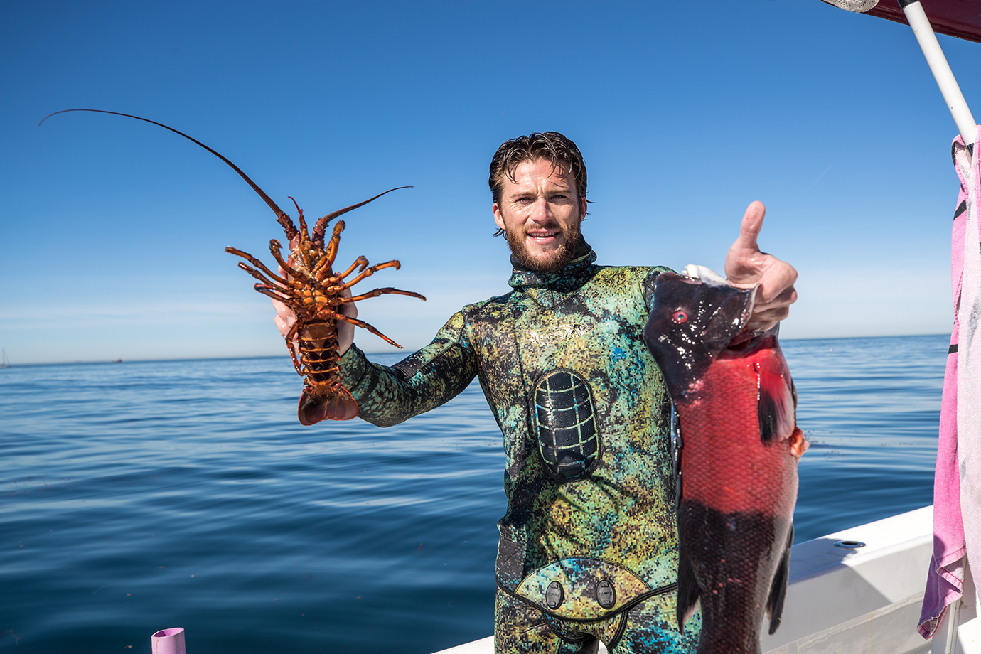 Scott Eastwood with freshly caught lobster and California sheepshead.