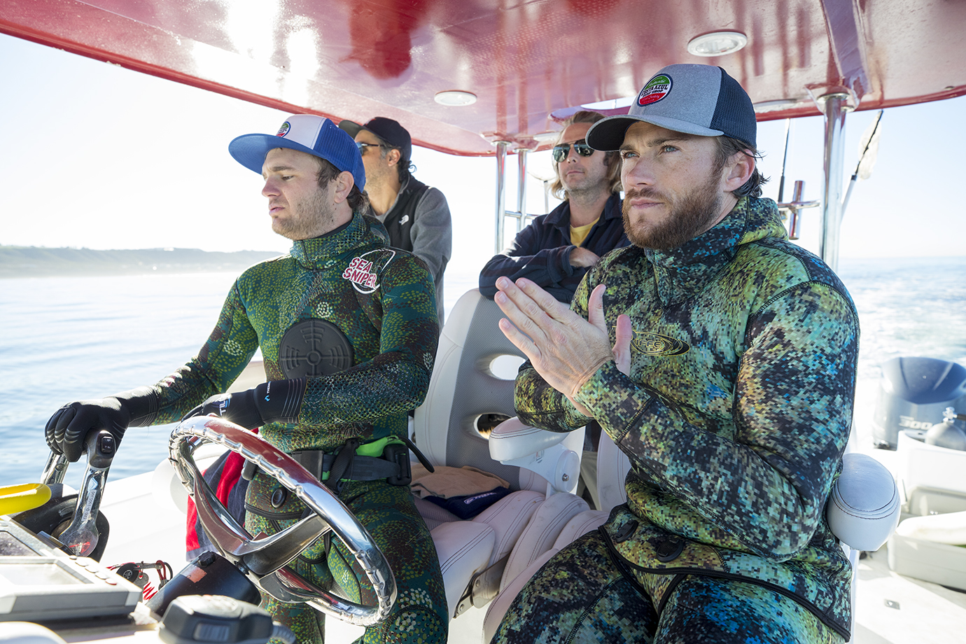 Scott Eastwood and his friends looking for a spearfishing spot.