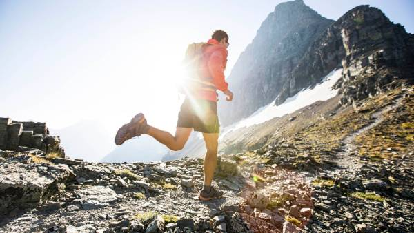 Trail running through the mountains of Glacier National Park.