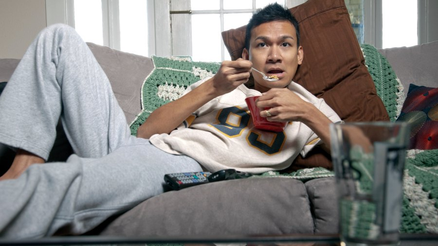 Man watching TV on couch