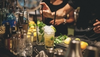 Bartender is preparing mojito cocktails.