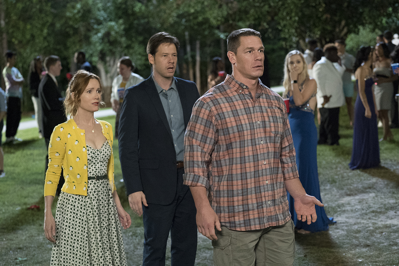 "Leslie Mann, Ike Barinholtz, and John Cena in the film ""Blockers"" which premieres April 6."