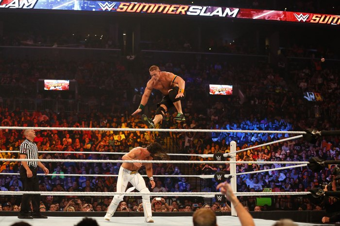 NEW YORK, NY - AUGUST 23: Seth Rollins and John Cena battle it out at the WWE SummerSlam 2015 at Barclays Center of Brooklyn on August 23, 2015 in New York City.