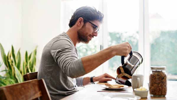 Man using French press coffee maker
