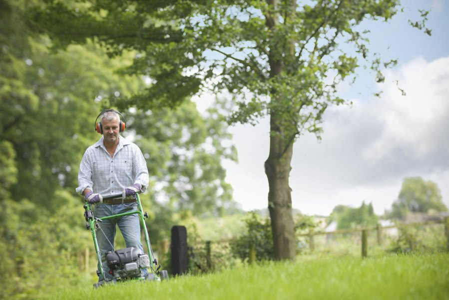Man On A Lawn Mower Stock Photo - Download Image Now - iStock