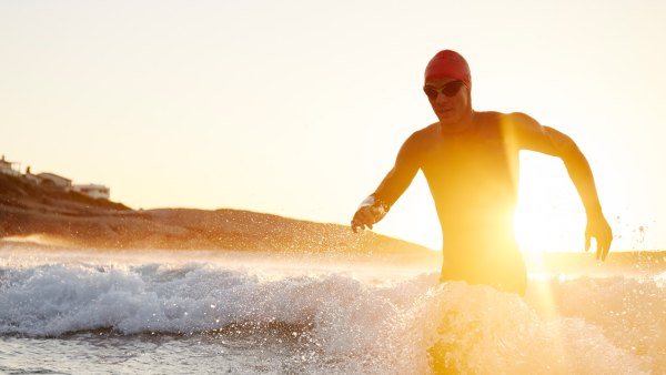 Triathlete coming out of surf