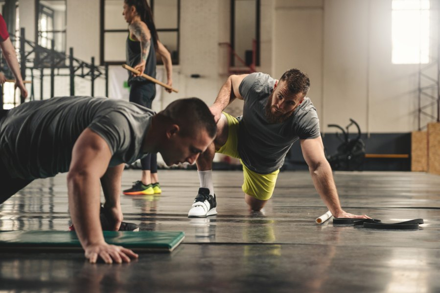 Man with personal trainer