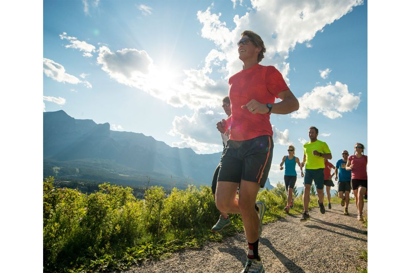 Runners-race-along-path-in-mountains