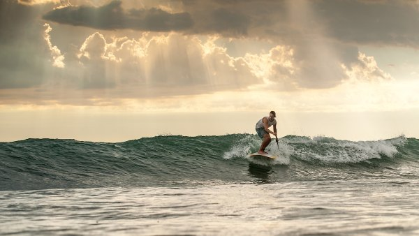 Will Taylor paddlesurfing in Southern California.