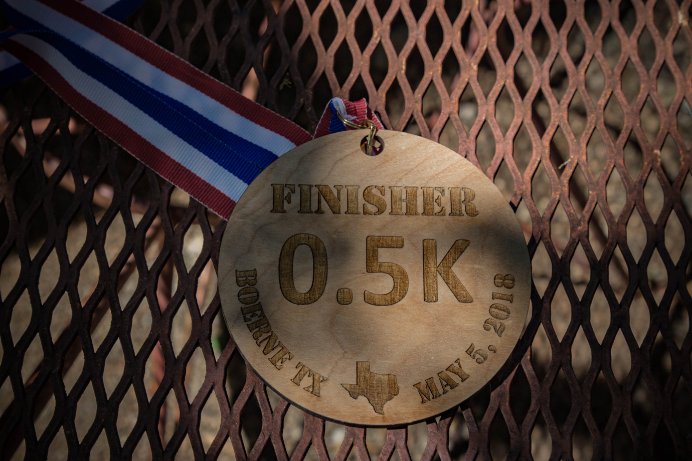 The medal for finshers of the 0.5K race in Boerne, Texas.
