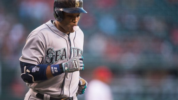Robinson Cano #22 of the Seattle Mariners blows bubblegum as he heads back to the dugout