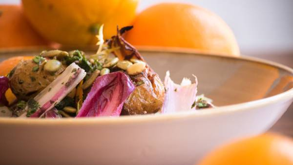 Chef Scott Walton's Grilled Baby Potato, Peach Salad with Chicory and Pumpkin Seeds