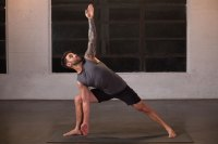 Man doing yoga on Manduka GRP Yoga Mat