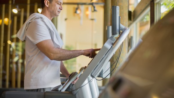 Middle-aged man running on treadmill