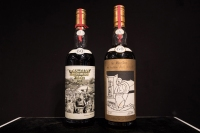 Two bottles of whisky, Macallan Peter Blake 1926 (L) and Valerio Adami 1926 (R), are displayed ahead of a Bonhams auction in Hong Kong on May 18, 2018. - Whisky prices have soared in recent years, with buyers shifting their attention from the bigger names to rare bottles from Scotland and Japan among others, according to Bonhams. (Photo by Dale DE LA REY / AFP) (Photo credit should read DALE DE LA REY/AFP/Getty Images)