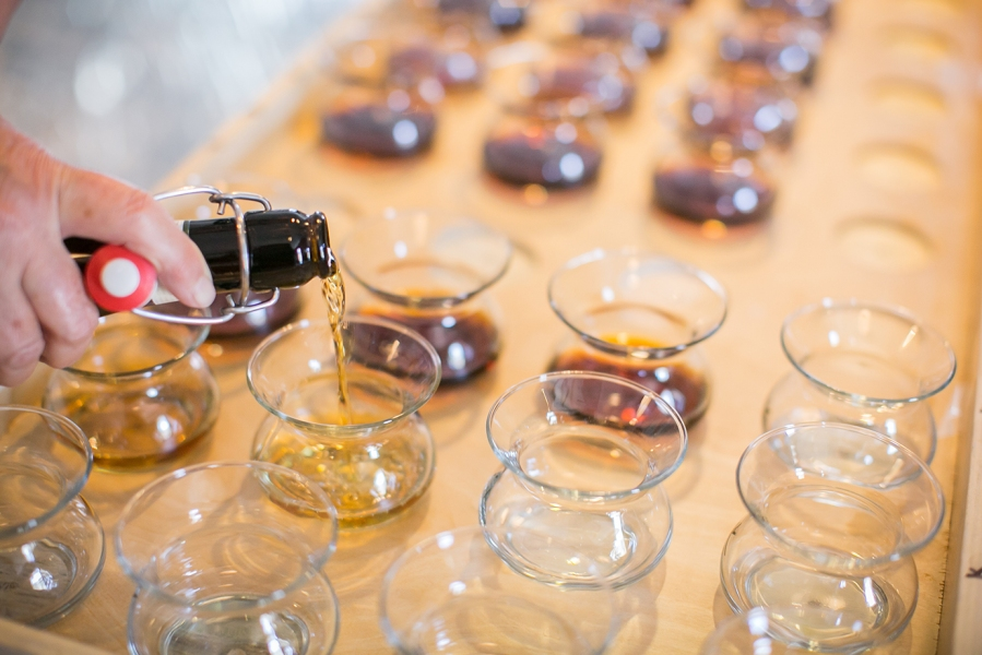 Tasting samples being poured into special glasses at the San Francisco World Spirits Competition.