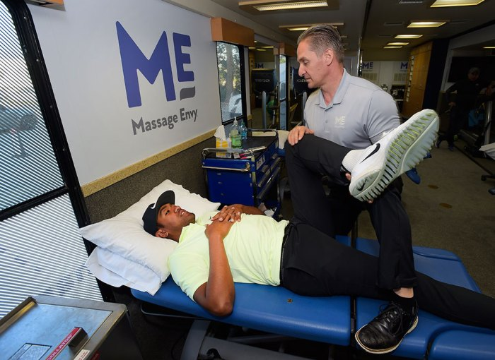 Tony Finau receives a treatment by Massage Envy Physical Therapist Jeff Hendra during the Genesis Open at Riviera Country Club on February 14, 2018 in Pacific Palisades, California.