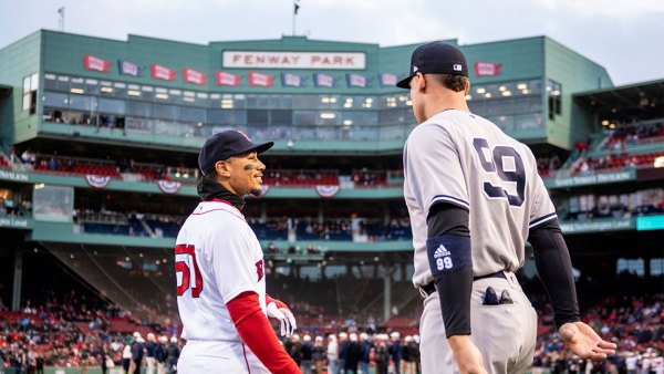 BOSTON, MA - APRIL 11: Mookie Betts #50 of the Boston Red Sox talks with Aaron Judge #99 of the New York Yankees before a game on April 11, 2018 at Fenway Park in Boston, Massachusetts.