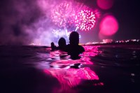 People watching fireworks in ocean