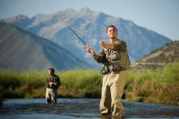 Man fly-fishing in mountains