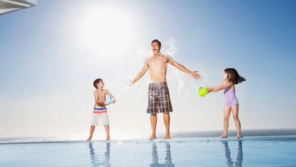 kids with dad at pool