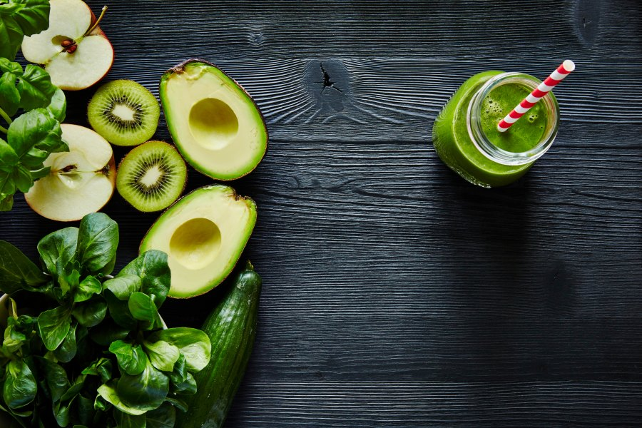 Green smoothie with vegetables, avocado, and kiwi