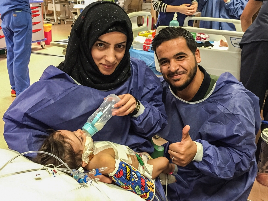 Parents Ashmaq and Saif, after their eight-month-old son's successful heart surgery