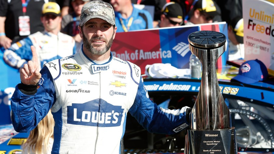 CHARLOTTE, NC - OCTOBER 09: Jimmie Johnson, driver of the #48 Lowe's Chevrolet, celebrates in victory lane after winning the NASCAR Sprint Cup Series Bank of America 500 at Charlotte Motor Speedway on October 9, 2016 in Charlotte, North Carolina. (Photo by Brian Lawdermilk/Getty Images)