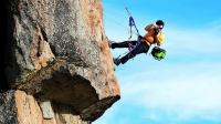 A photographer photographs a rock climber in Calif.