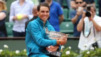 Rafael Nadal of Spain celebrates winning his 11th French Open during the trophy ceremony on Day 15 of the 2018 French Open at Roland Garros stadium on June 10, 2018 in Paris, France.