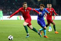 Cristiano Ronaldo of Portugal, Tony Vilhena of the Netherlands during the international friendly match between Portugal and the Netherlands at Stade de Geneve on March 26, 2018 in Geneva, Switzerland.