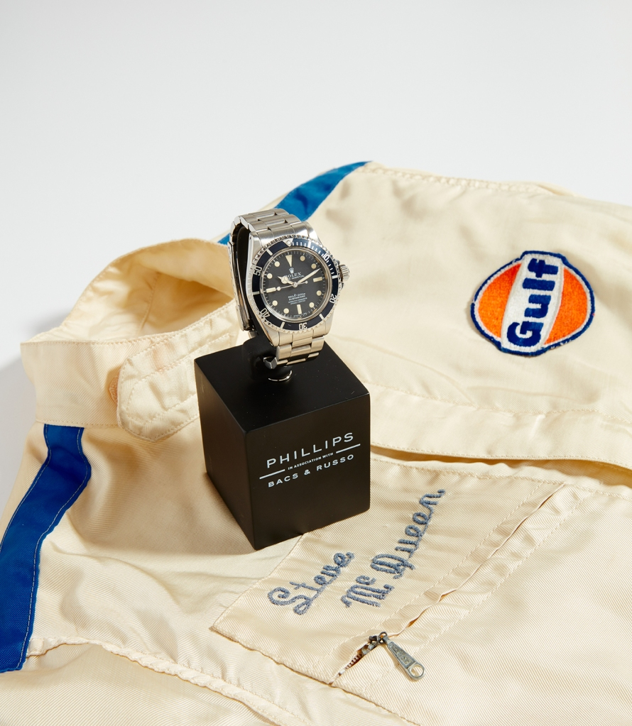 A Rolex Submariner that once belonged to Steve McQueen, along with the actor's personalized racing jumpsuit.