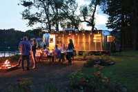 People eating at night outside of Airstream