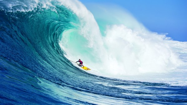 Kai Lenny paddleboard surfing in Maui