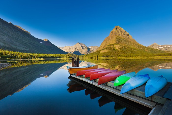 A group of canoes resting at the dock deck at Many Glacier Swiftcurrent Lake at Glacier National Park