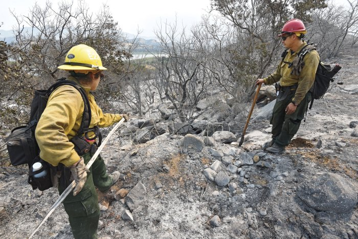 Firefighters mop up the last of the hot spots from the 2017 Whittier Fire, in Santa Barbara County, which burned more than 18,000 acres