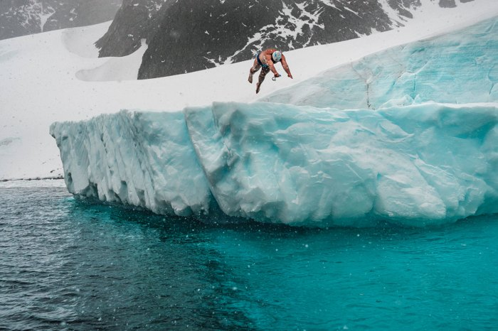 Lewis Pugh diving off an iceburg in Antarctica in 2017
