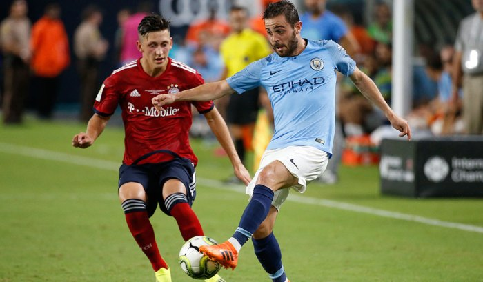 Manchester City's Portuguese midfielder Bernardo Silva (R) vies for the ball with Bayern Munich's German defense Jonathan Meier during the International Champions Cup friendly match between FC Bayern Munich and Manchester City at Hard Rock Stadium in Miami, Florida, on July 28, 2018.