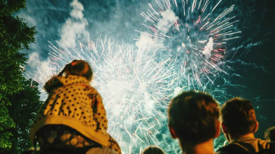 Low Angle View Of People Watching Fireworks